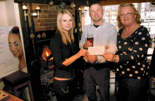 The Horns, Ashbourne.  Cheque presented by Jo-anne Jewett and Lorna Etches to Mike Gerard-Pearse, chairman of Parwich Memorial Hall Management committee.  Reproduced by kind permission of the Ashbourne News Telegraph.  Please click image to enlarge.